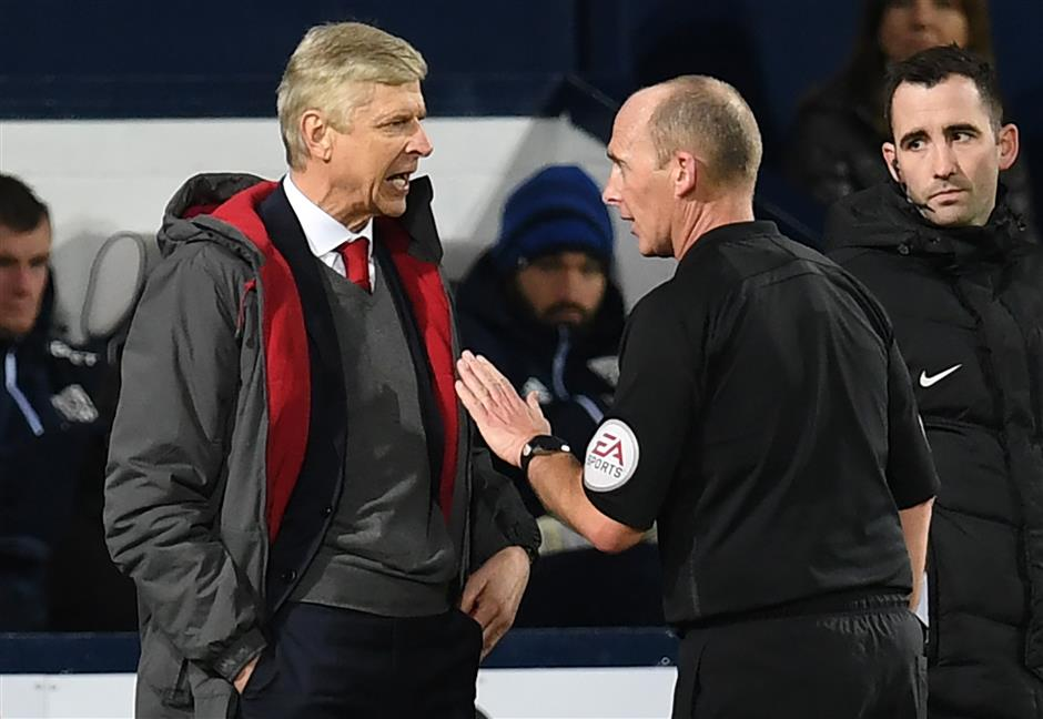 Wenger charged for comments against referee