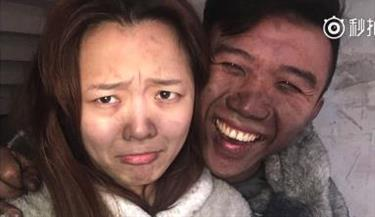 Young couple take selfies at home after fire