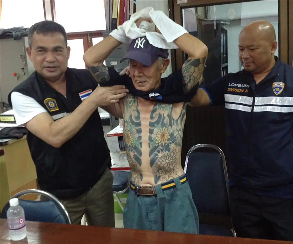 Japanese crime boss held in Thailand after 'yakuza' tatts go viral