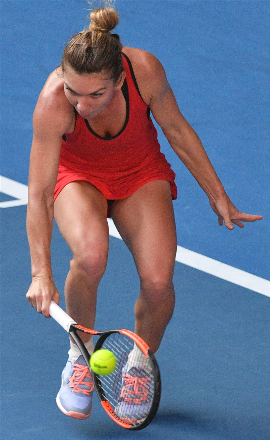 Halep outlasts Kerber in thriller to reach final