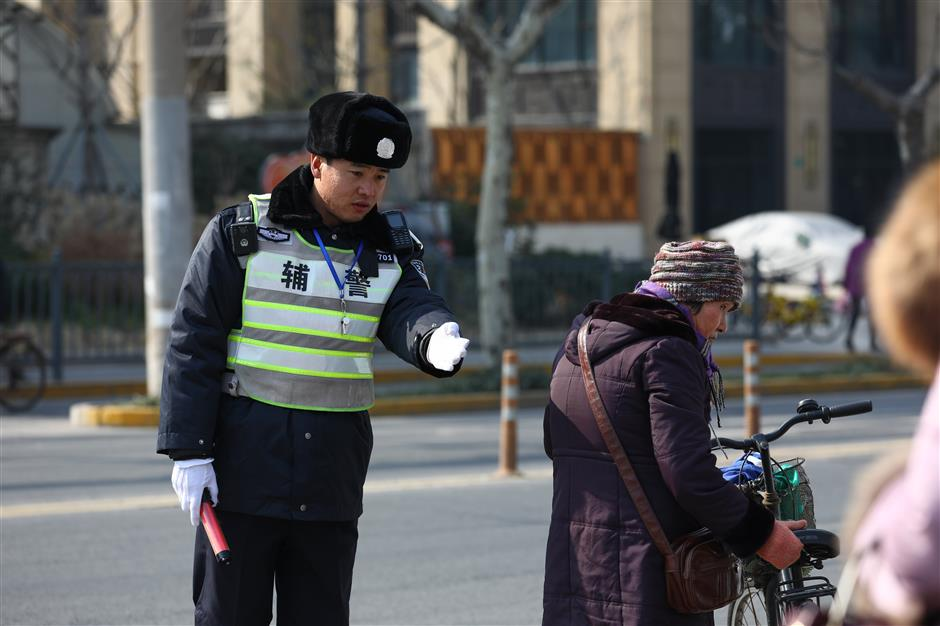 Assistants offer extended arms to city traffic police