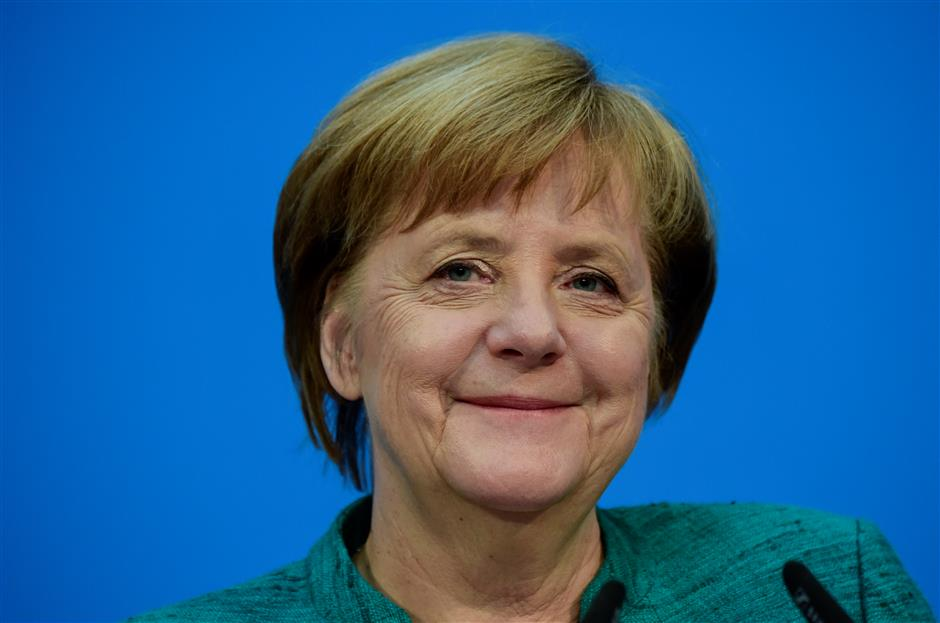 Relieved Merkel clinches hard-fought deal on new government