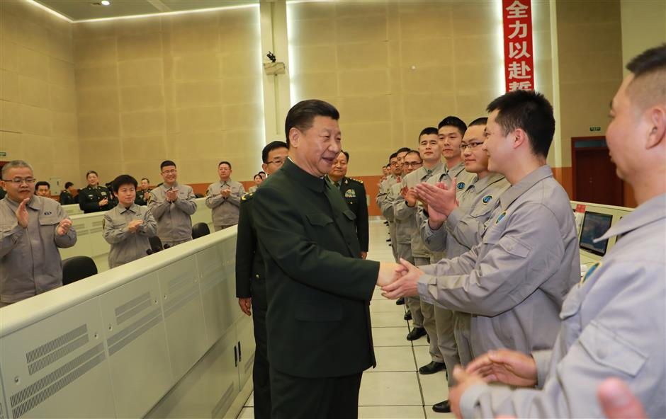 Xi visits military base, extends festival greetings to all servicemen