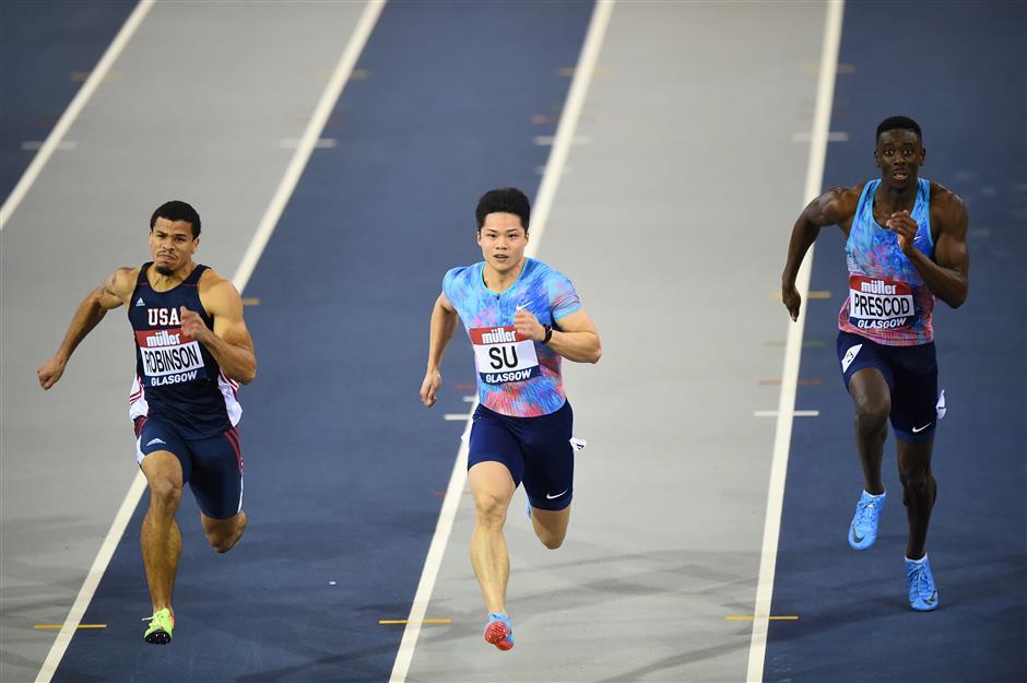 China's SuBingtian wins his heat in the men's 60 meters in Glasgow