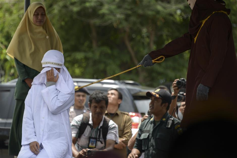 Indonesians whipped over sharia-banned children's play