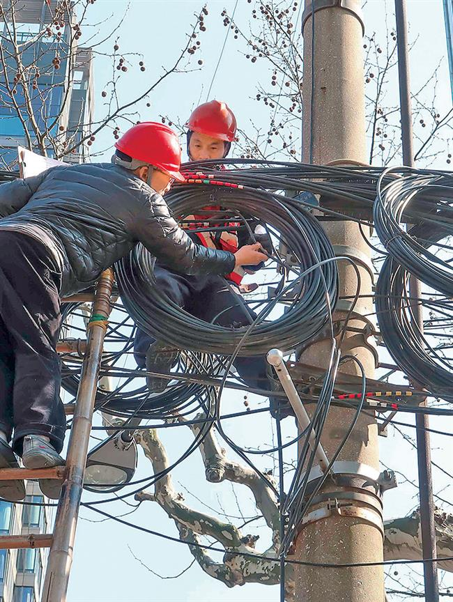 City launches drive to remove overhead cables