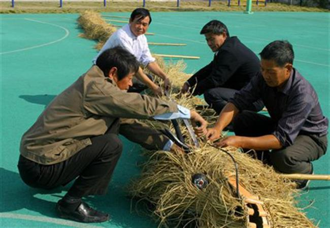 New members are trained in straw dragon dancing