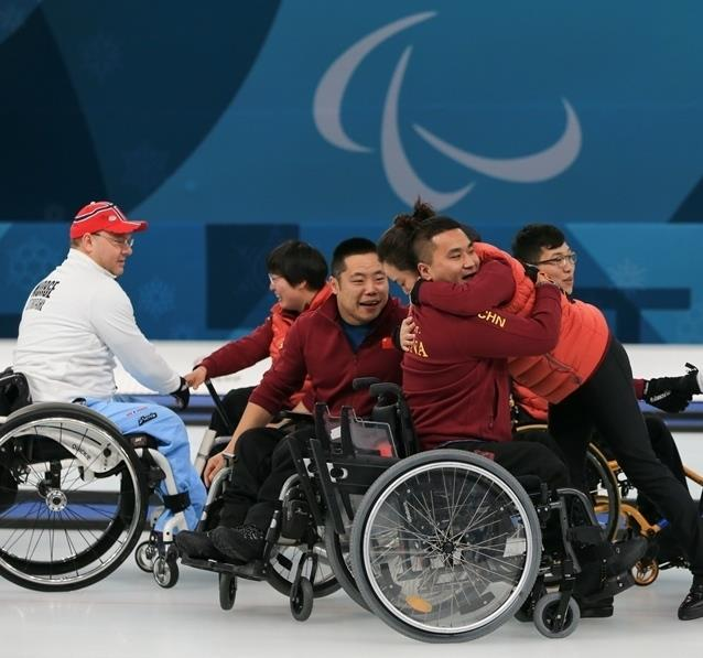 China wins first-ever Winter Paralympic medal with gold in wheelchair curling