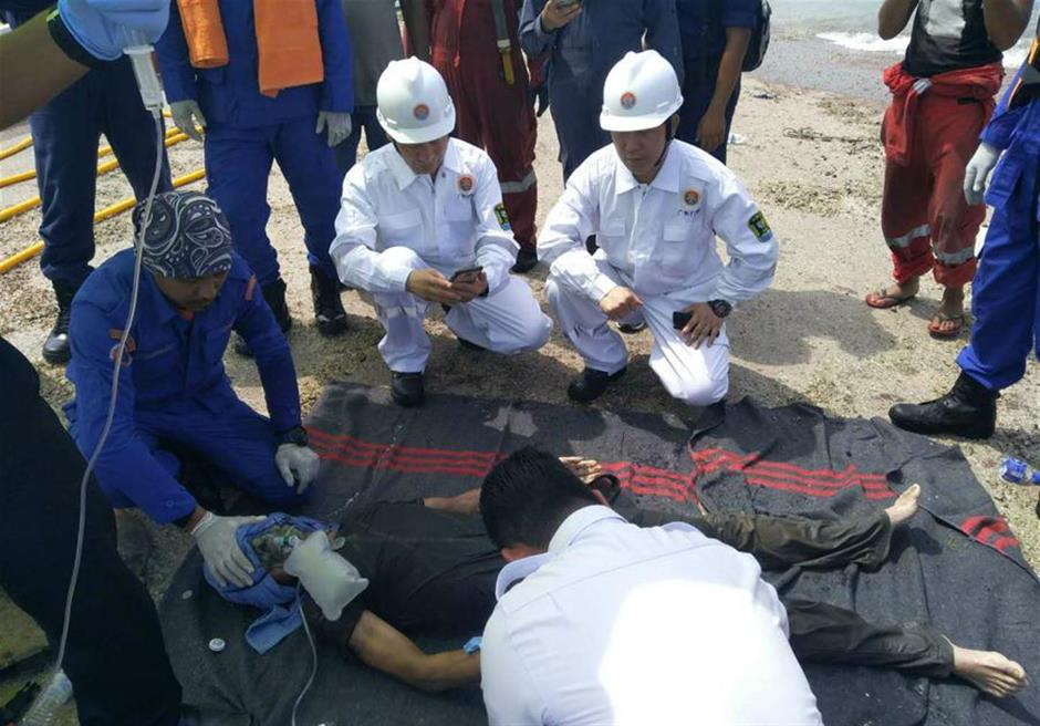 Two Chinese crew rescued from inside sand dredger capsized near Malaysia