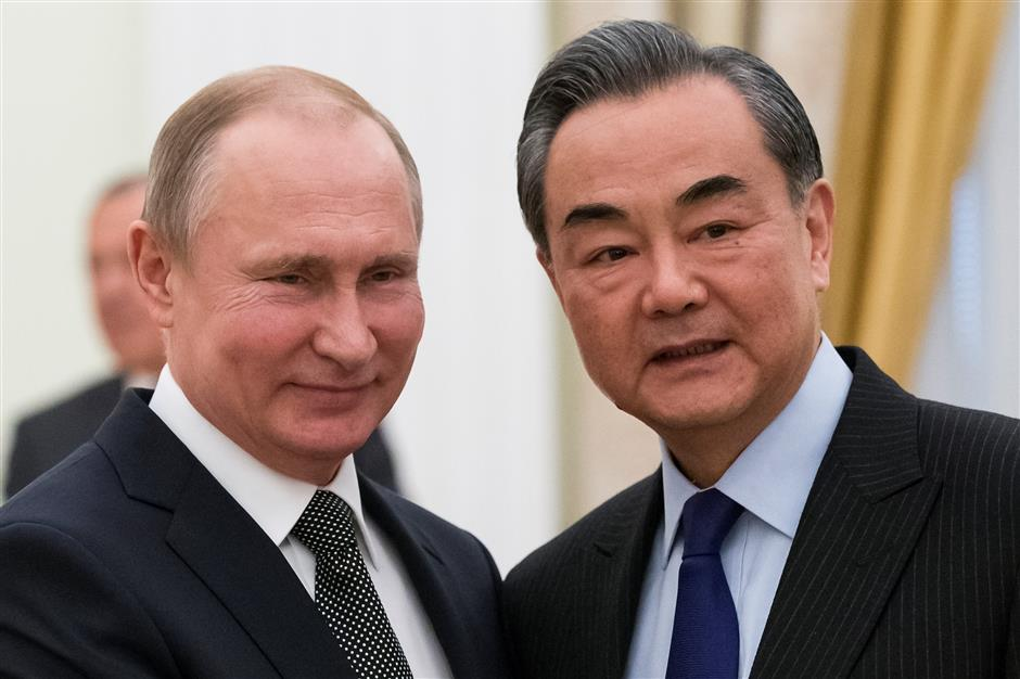 Putin to visit China in June as Beijing, Moscow pledge to develop bilateral ties