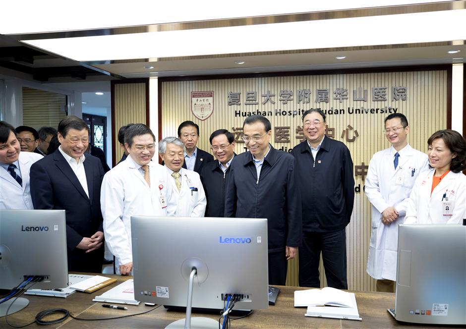 Li calls on Shanghai to drive reform