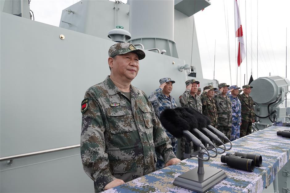 President Xi reviews navy in South China Sea