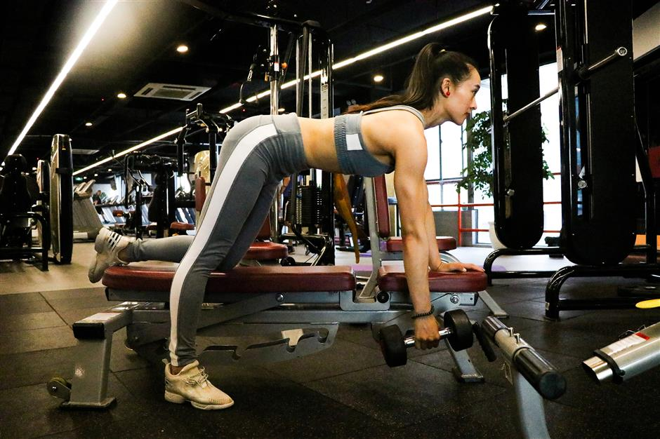 Muscle Barbie works up a sweat on social media