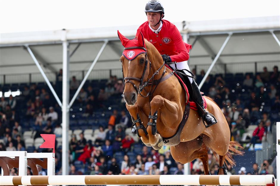 Riders gallop into the second day of show jumping competition