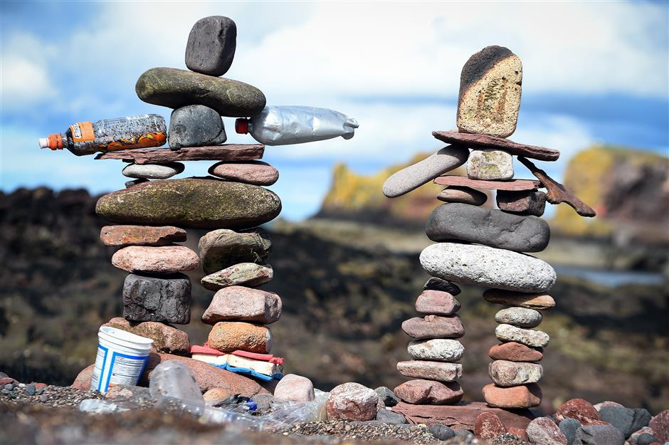 Stone stacking contest brings gravity-defying sculptures to Scottish beach