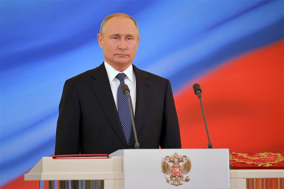 Russia's Putin sworn in for another six years in office