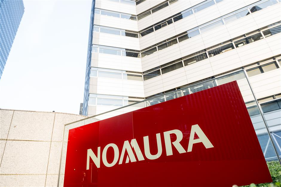 Japanese securities trader Nomura plans to set up holding firm in China