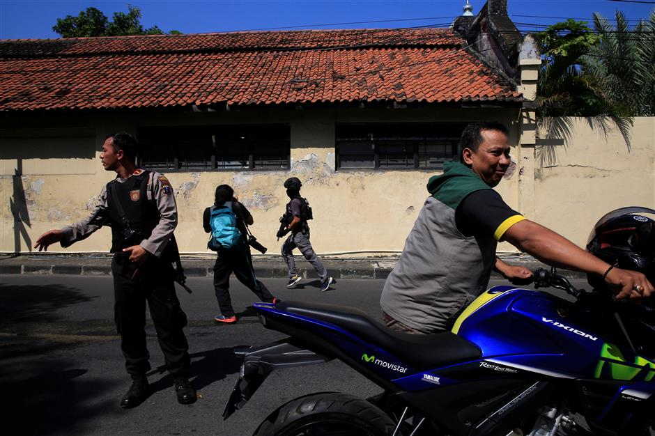 4 killed, 10 injured as suicide bombing hits police headquarters in Indonesia