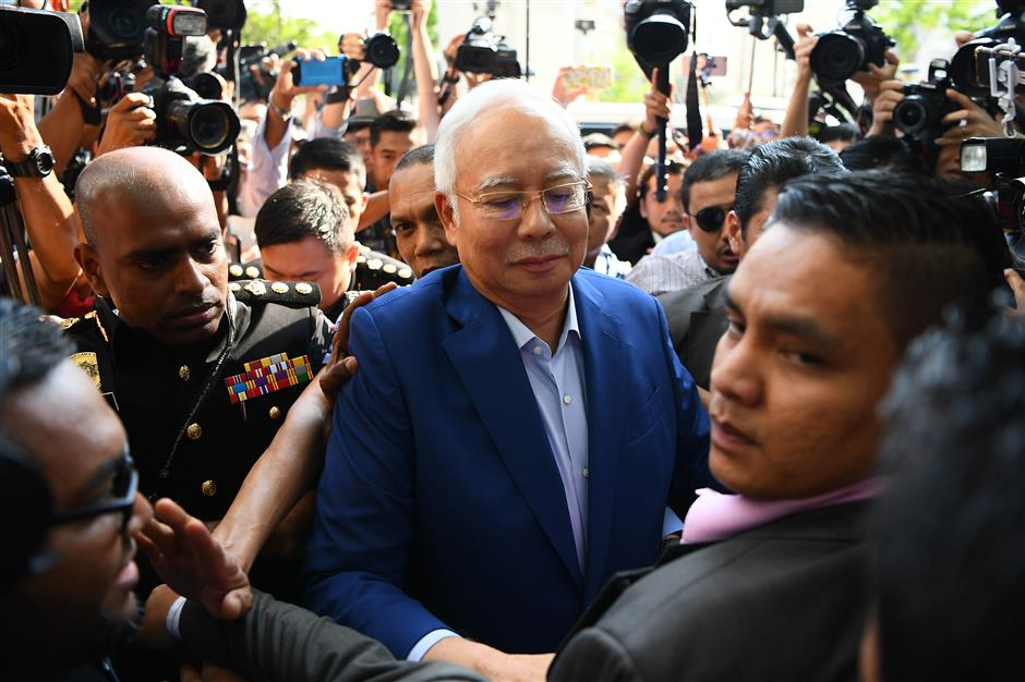Former Malaysian PM Najib arrives at anti-corruption agency for questioning