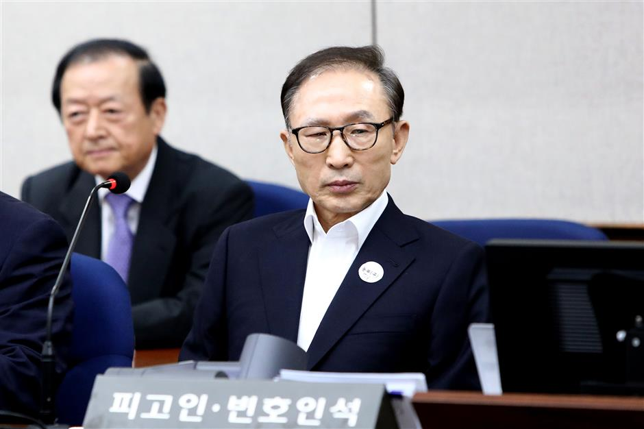 Ex-S.Korean President Lee Myung-bak appears at first trial over corruption charges