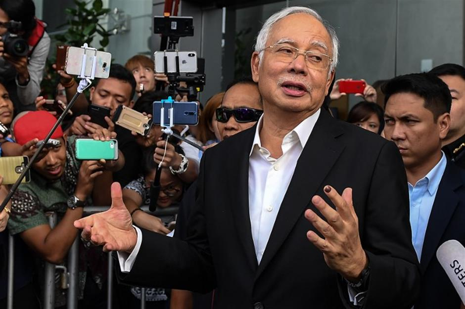 Large amounts of cash seized from apartments linked to former Malaysian PM Najib: police