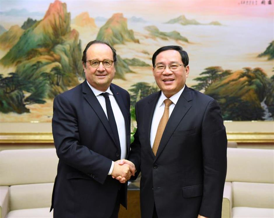 Shanghai Party chief meets former French President Francois Hollande