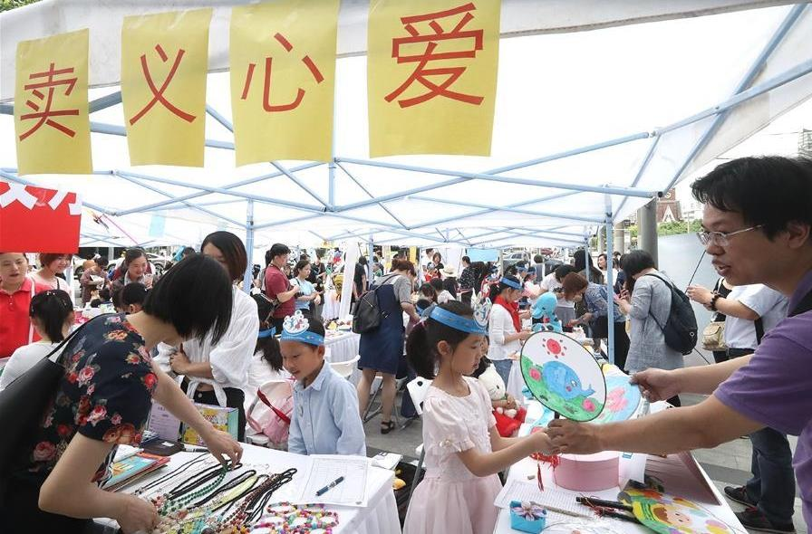 Charity fair held in Shanghai to help children living in impoverished areas