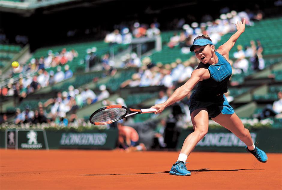 Halep into third Roland Garros final