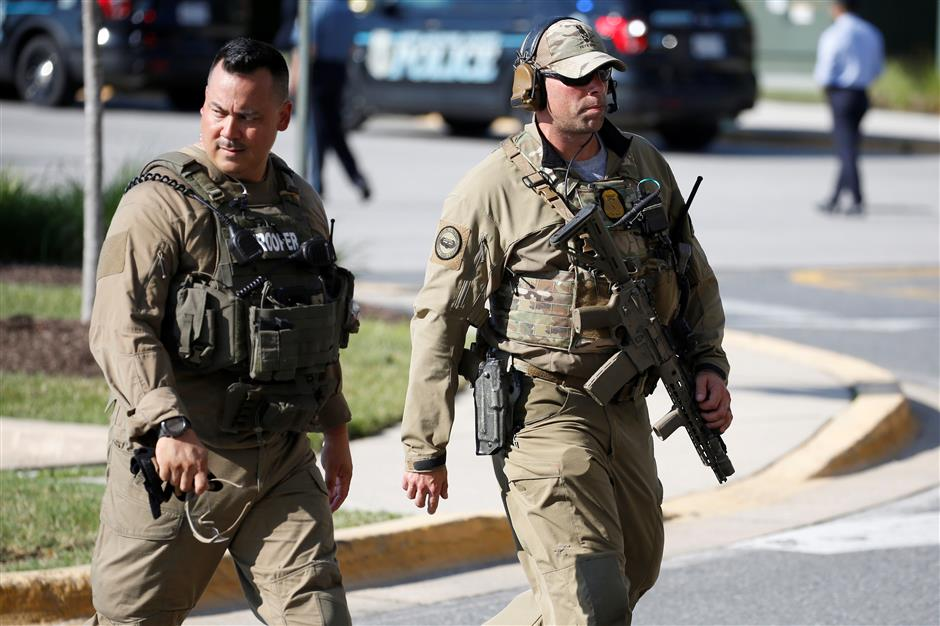 Gunman angry at Maryland newspaper kills 5 in targeted attack