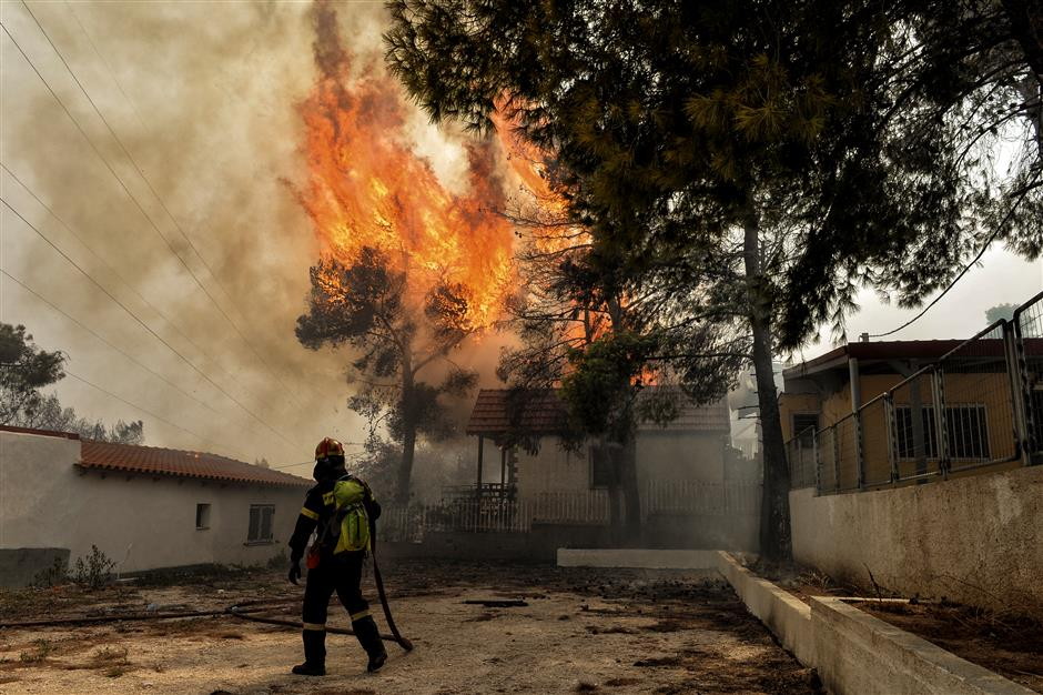 Wildfires kill at least 74 near Athens, families embrace as flames close in