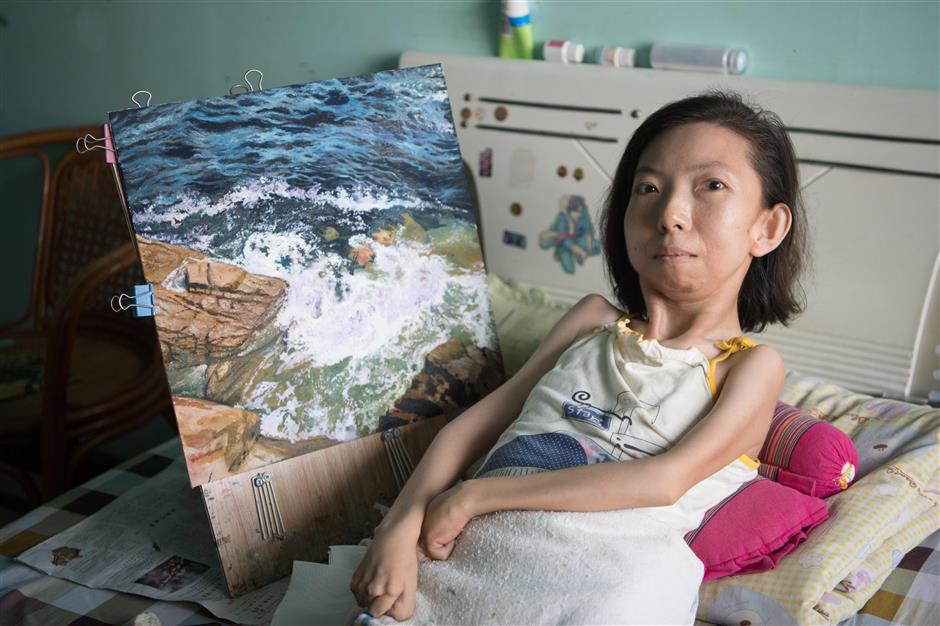 Woman paralyzed for 30 years earns living by painting