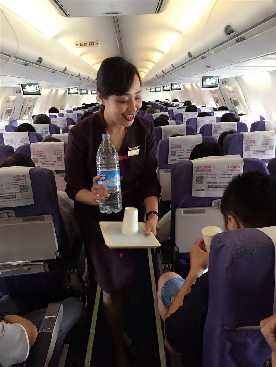 Air hostess, former factory worker, 55, flies on
