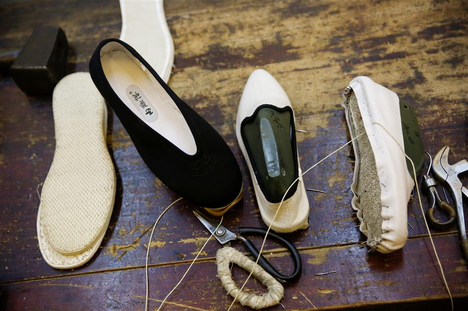 Historic Beijing cobbler taps into the future
