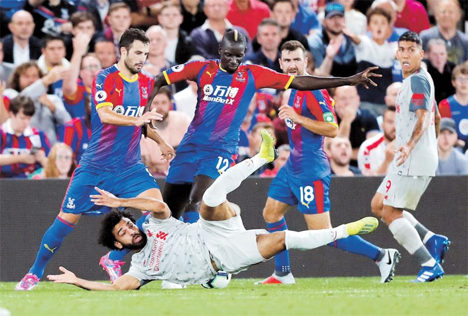 Salah in diving storm as Liverpool win at Palace