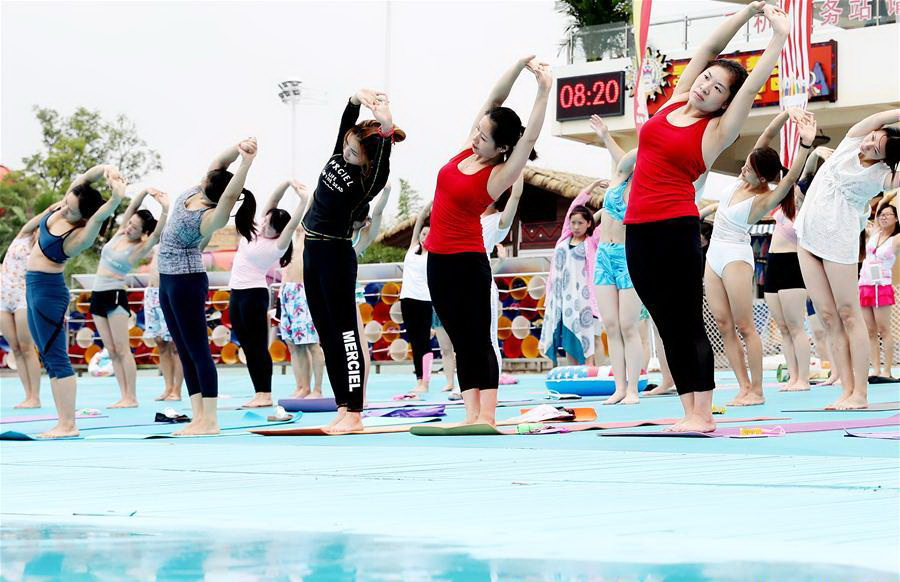 People practise yoga at park in Shanghai