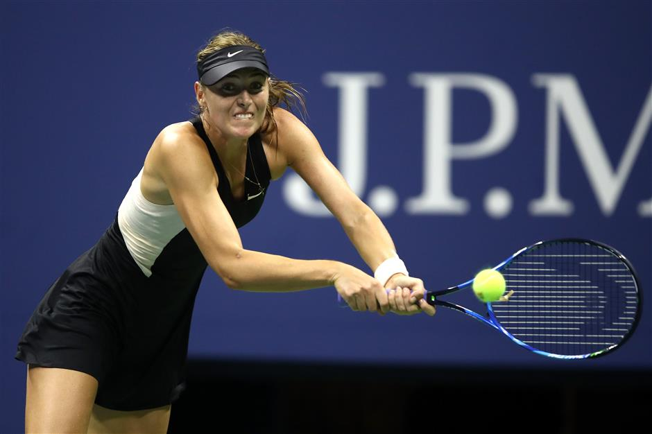 Black night as Federer, Sharapova crash at US Open