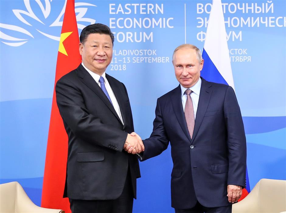 Xi, Putin vow to promote ties regardless of global changes