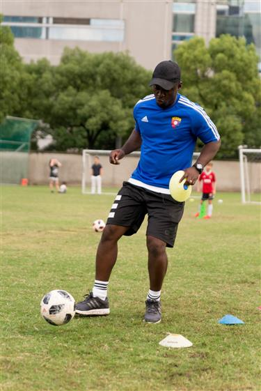 From playing in streets of Accra to Shanghai, coach is pitch perfect