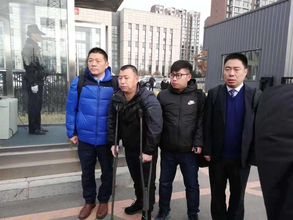 Acquitted man leaves court on crutches after 23 years behind bars