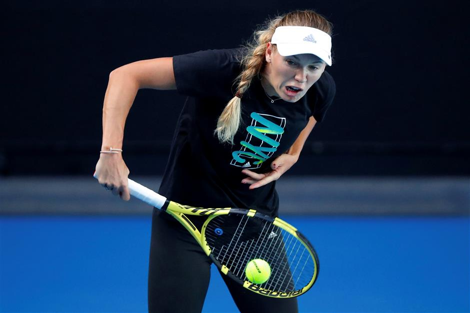 Champions Wozniacki, Federer on different ends of spectrum
