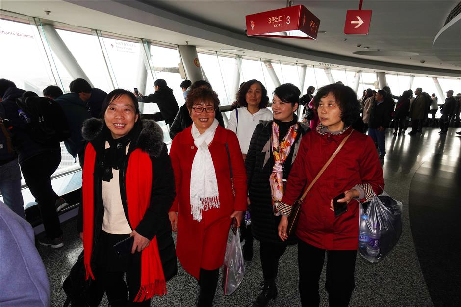 Domestic helpers celebrateInternational Women's Day inside Oriental Pearl