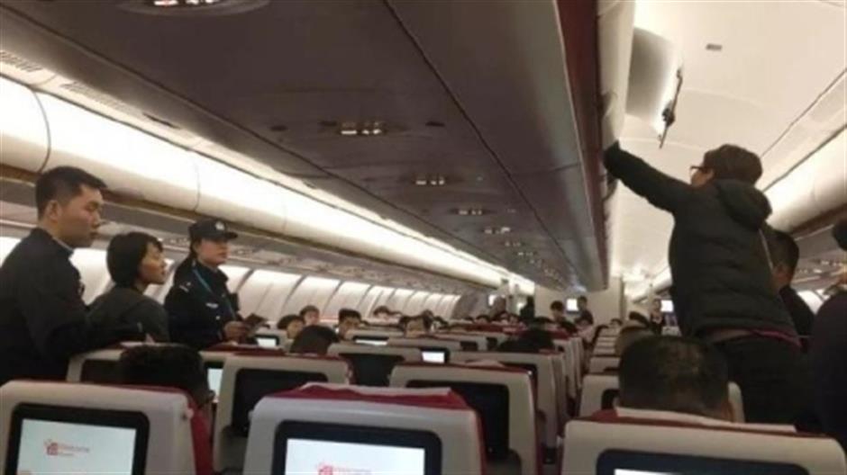 Flight delayed after 2 women toss coins for good luck