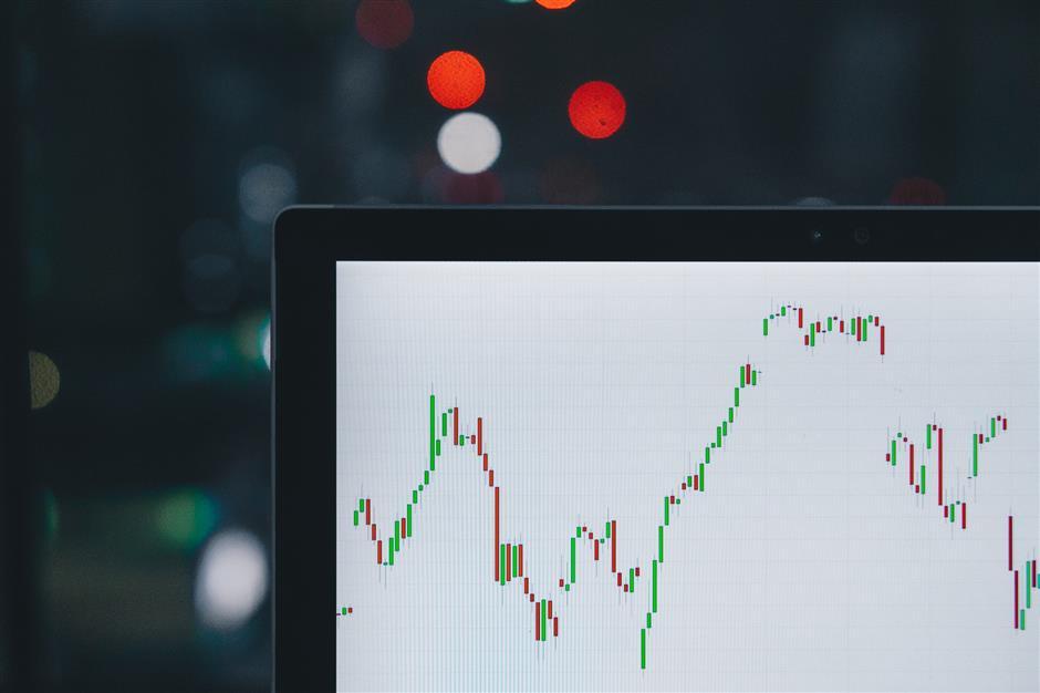 Stocks surge on tax cut, positive data