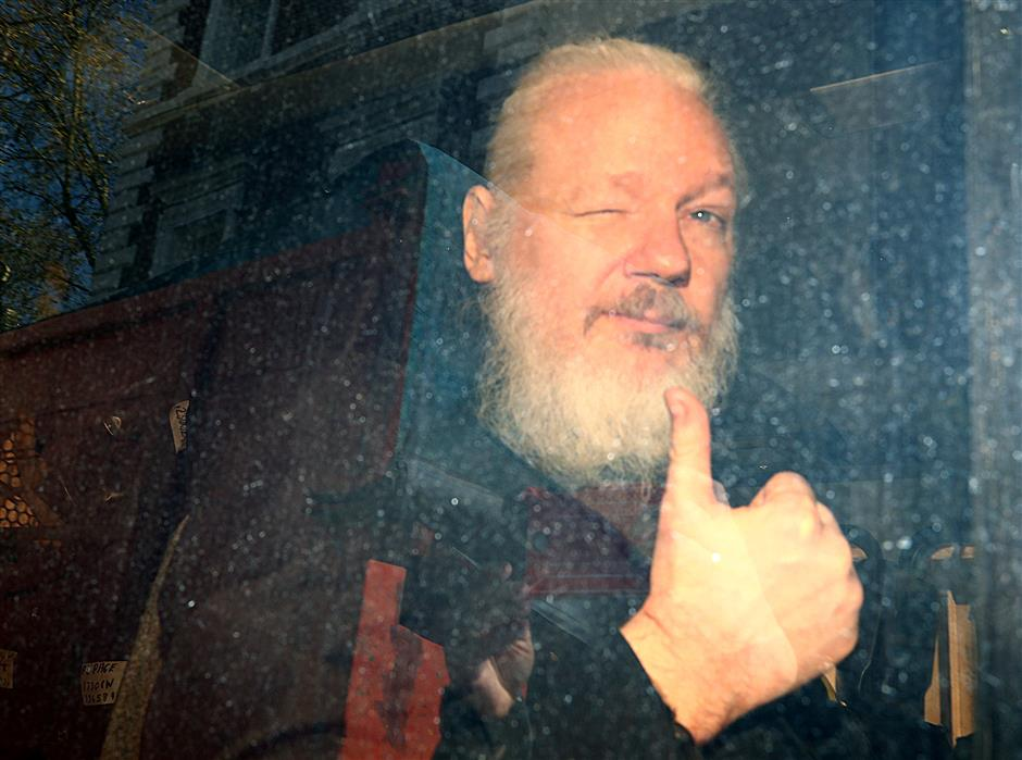 Assange arrested in London, faces hacking charges in US