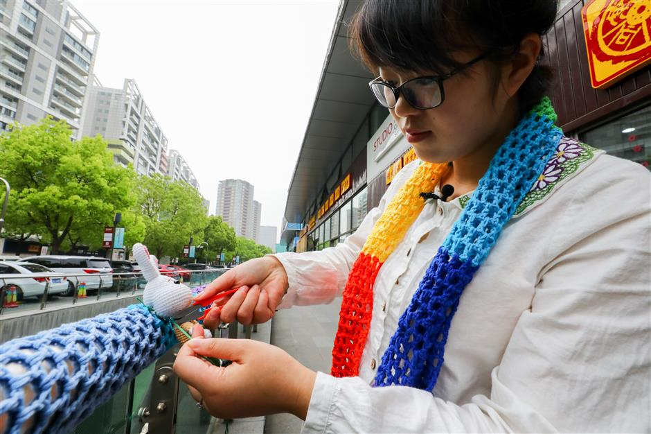 How did a business street in Pudong become festooned with knit dolls?