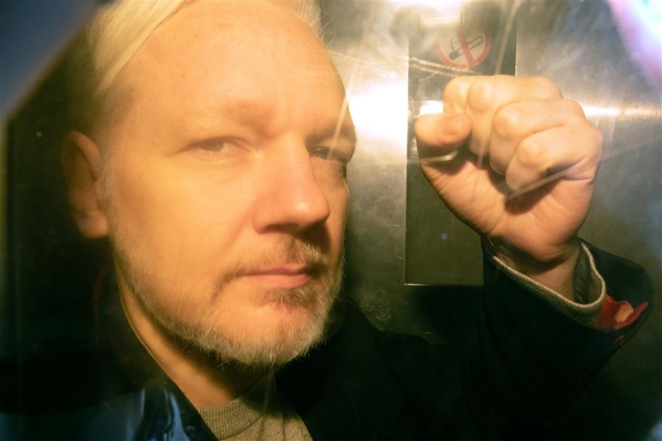 Apologetic Assange is jailed for 50 weeks
