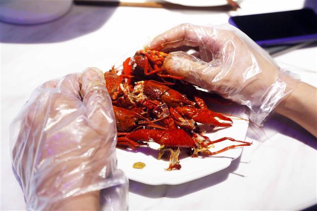 A job with good pickings: crayfish peeling