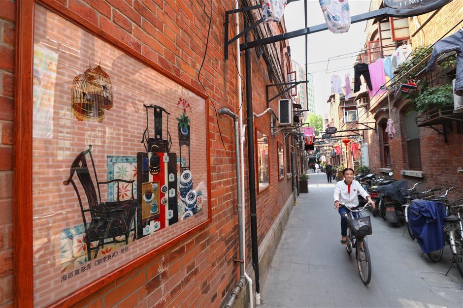 Shikumen lane adorned with traditional paintings