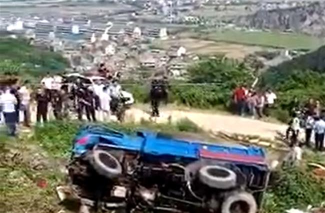 Illegally loaded farm vehicle overturns, killing 12