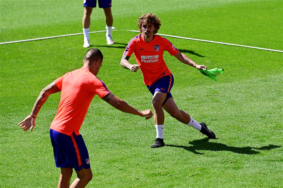 Simeone to face tough challenge without Griezmann, Godin